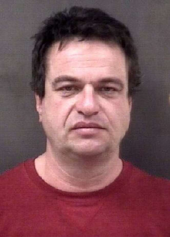 Myles Safyre, 48, was charged with threatening and breach of peace after he allegedly pulled on a construction worker. Photo: Contributed Photo / Milford Police / Contributed Photo / Connecticut Post Contributed