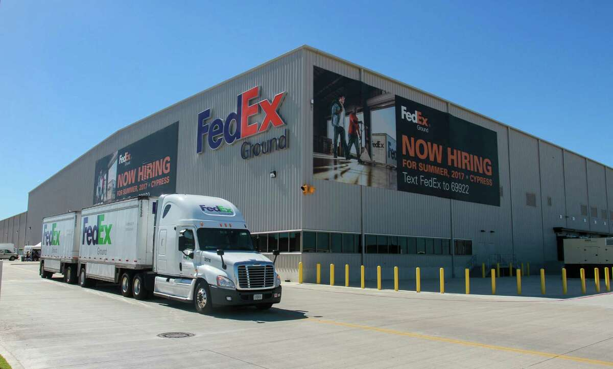 A FedEx truck leaving the new FedEx Ground 800,000-square-foot automated distribution hub in Houston. (For the Chronicle/Gary Fountain, October 26, 2017)