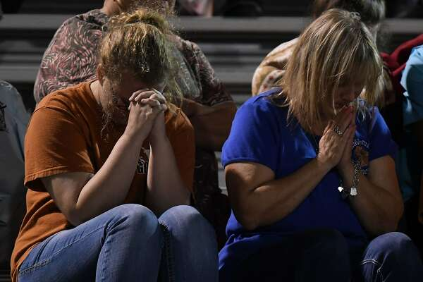 People pray during a memorial service for victims of the mass shooting that killed 26 people in Sutherland Springs, at the La Vernia High School in Texas on November 7, 2017. A gunman wearing all black armed with an assault rifle opened fire on a small-town Texas church during Sunday morning services, killing 26 people and wounding 20 more in the last mass shooting to shock the United States. / AFP PHOTO / MARK RALSTONMARK RALSTON/AFP/Getty Images