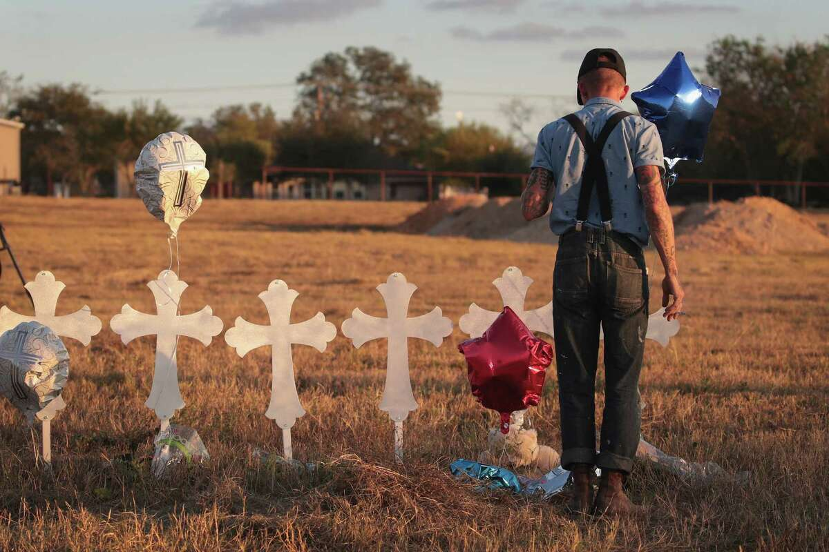 SUTHERLAND SPRINGS, TX - NOVEMBER 07: Derrick Bernaden of San Antonio, Texas visits a memorial where 26 crosses stand in a field on the edge of town to honor the 26 victims killed at the First Baptist Church of Sutherland Springs on November 7, 2017 in Sutherland Springs, Texas. On November 5, a gunman, Devin Patrick Kelley, shot and killed the 26 people and wounded 20 others when he opened fire during a Sunday service.