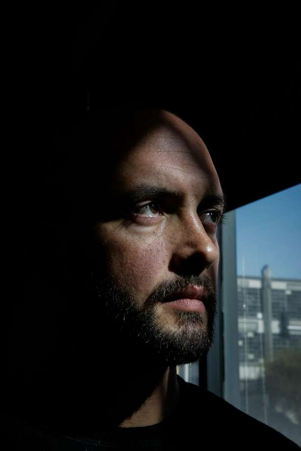 """Kevin Miller, a Marine Corps Iraq combat veteran, works in San Francisco for Swords to Plowshares, where he keeps a """"yoga joe"""" statue on his desk. Miller and other veterans with health care issues would suffer under legislation being drafted in Washington. Photo: Gabrielle Lurie, The Chronicle"""