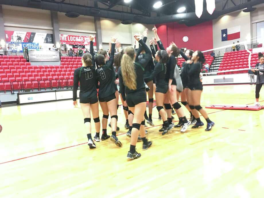 The Kingwood Park Panther volleyball team celebrates after their 3-0 victory over the Santa Fe Indians in the regional quarterfinal Tuesday night at Lee College in Baytown, advancing to the regional semifinals for the first time in school history Photo: Elliott Lapin