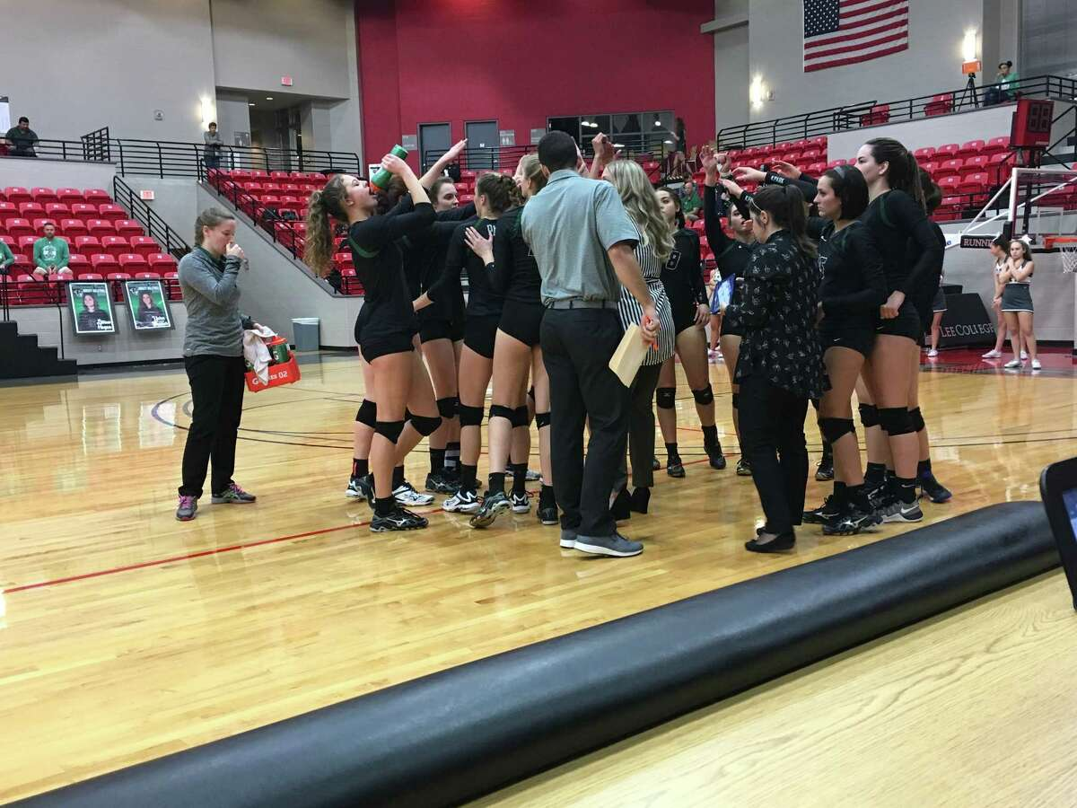 The Kingwood Park Panther volleyball team breaks a huddle during their 3-0 victory over the Santa Fe Indians in the regional quarterfinal Tuesday night at Lee College in Baytown, which advanced the team to the regional semifinals for the first time in school history