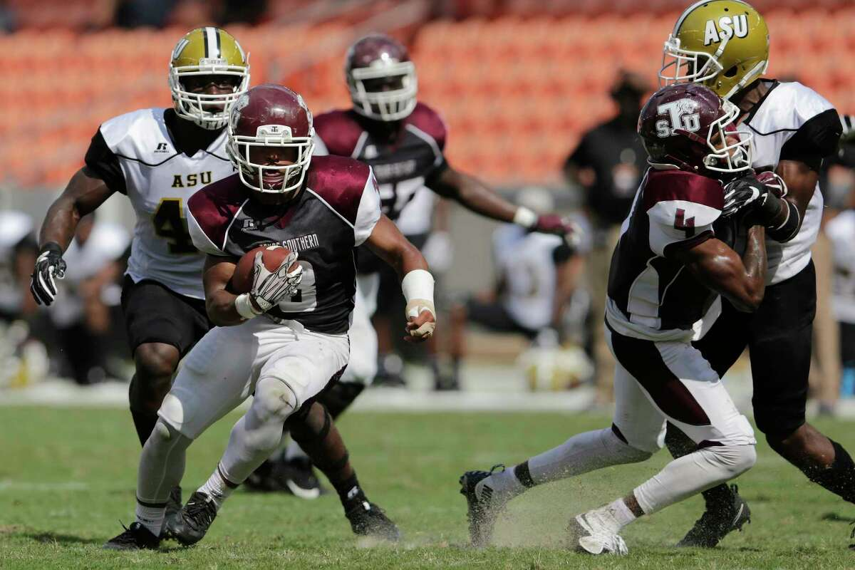 Texas Southern Tigers running back Tylor Cook (3) runs the ball behind the blocking of wide receiver Darvin Kidsy (4) in the second quarter during the NCAA football game between the Alabama State Hornets and the Texas Southern Tigers at BBVA Compass Stadium in Houston, TX on Saturday, October 14, 2017.