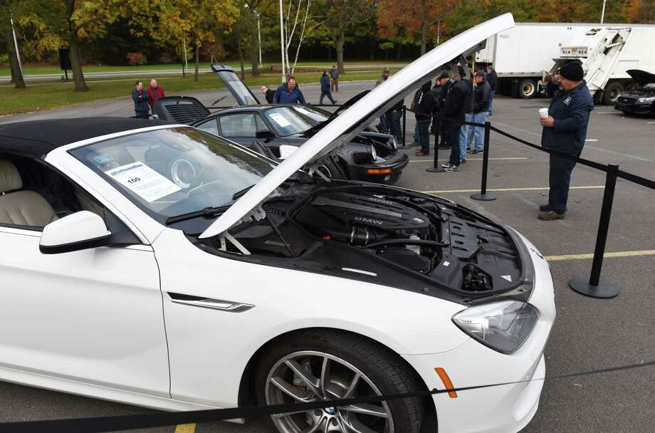A 2012 BMW 650 convertible; 1986 Porsche 911 Turbo and a Lamborghini Gallardo are viewed during a state Office of General Services surplus vehicle and equipment auction on Wednesday, Nov. 8, 2017, at the Harriman Campus in Albany, N.Y. (Will Waldron/Times Union) Photo: Will Waldron, Albany Times Union / 20042050A