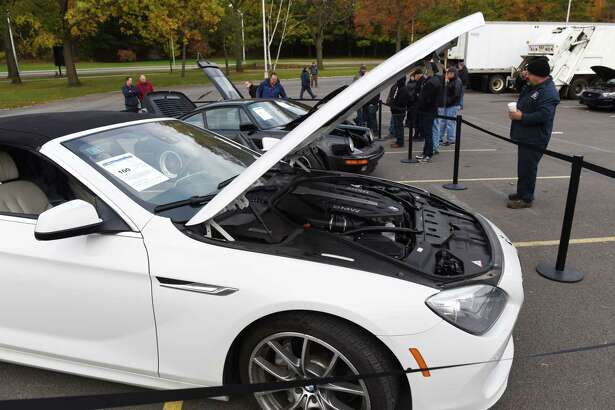 A 2012 BMW 650 convertible; 1986 Porsche 911 Turbo and a Lamborghini Gallardo are viewed during a state Office of General Services surplus vehicle and equipment auction on Wednesday, Nov. 8, 2017, at the Harriman Campus in Albany, N.Y. (Will Waldron/Times Union)