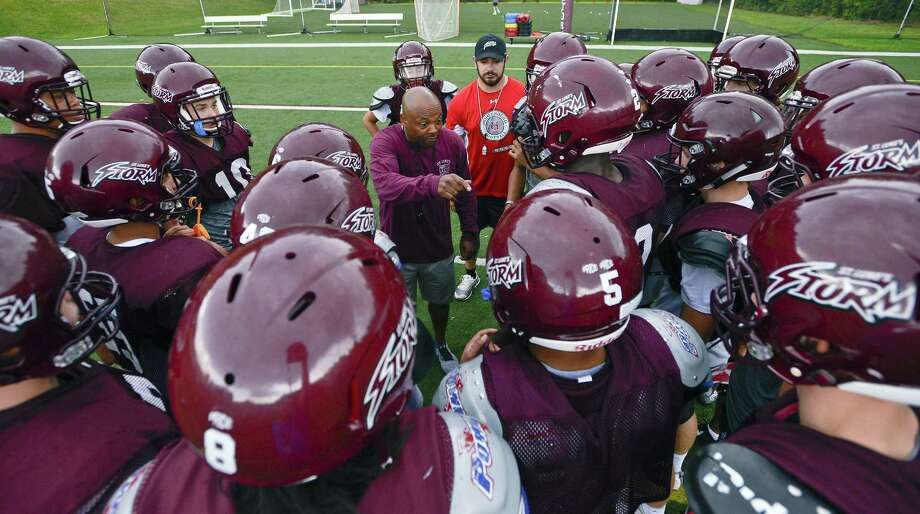 St. Luke's coach Noel Thomas, center, talks with his players as they huddle up for a team practice at the school on Sept. 14 in New Canaan. Photo: Matthew Brown / Hearst Connecticut Media / Stamford Advocate