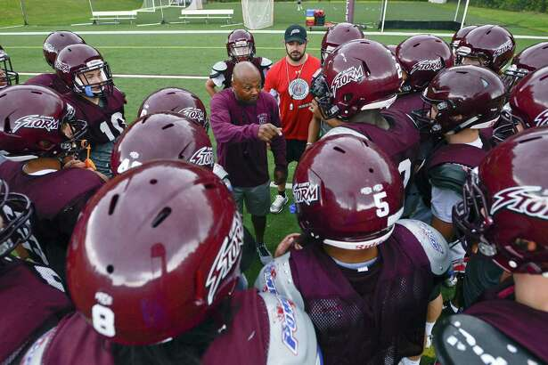 St. Luke's coach Noel Thomas, center, talks with his players as they huddle up for a team practice at the school on Sept. 14 in New Canaan.