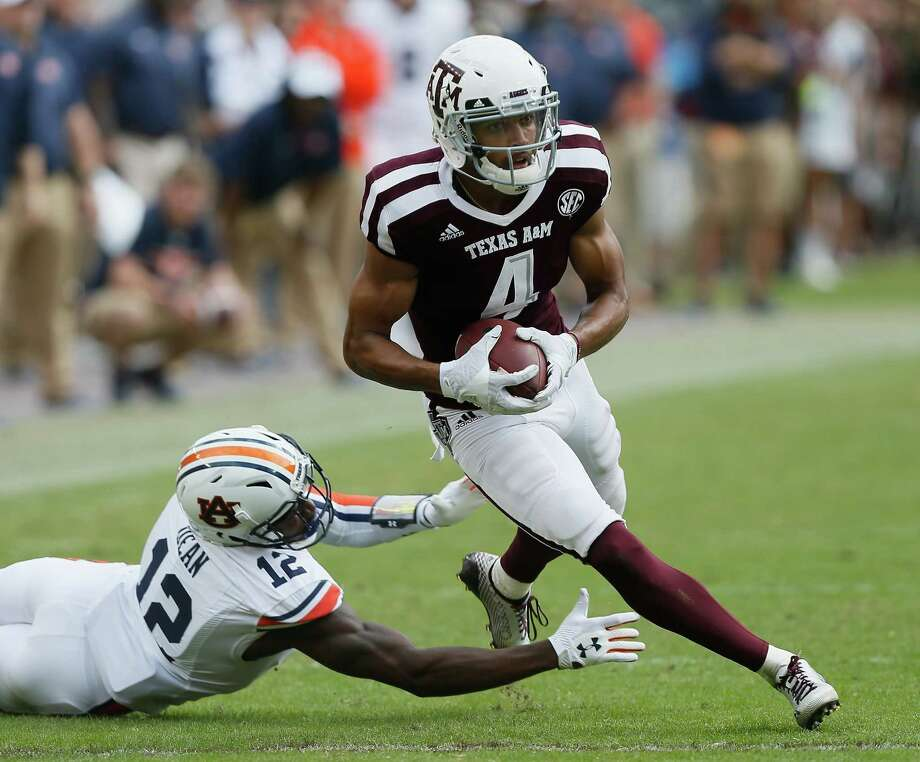 Damion Ratley #4 of the Texas A&M Aggies avoids the tackle attempt by Jamel Dean #12 of the Auburn Tigers at Kyle Field on November 4, 2017 in College Station, Texas.  (Photo by Bob Levey/Getty Images) Photo: Bob Levey, Stringer / 2017 Getty Images