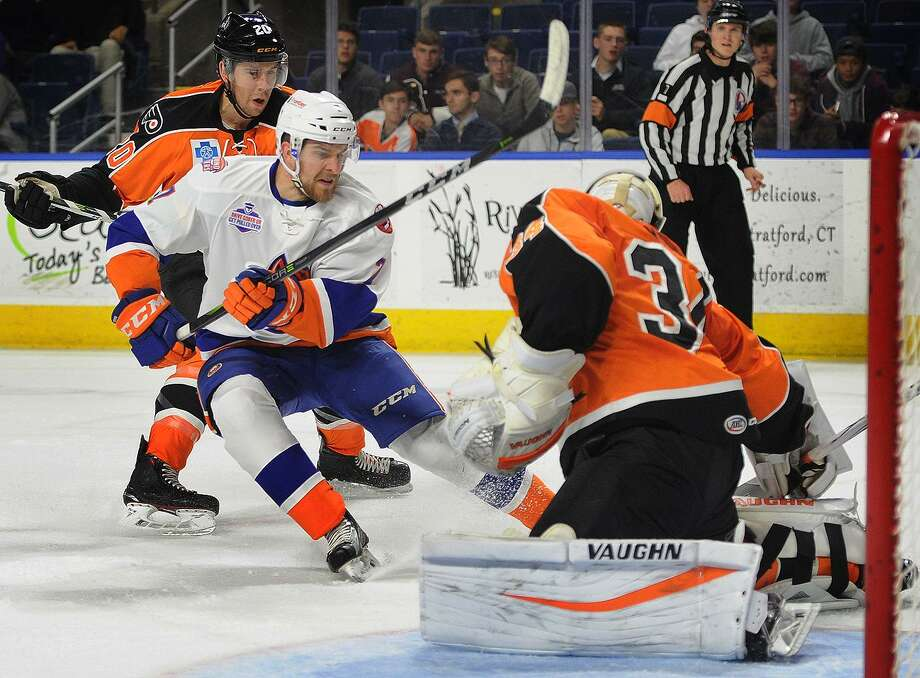 Bridgeport Sound Tiger Devon Toews takes a breakaway shot on Lehigh Valley Phantoms goalie Alex Lyon during their AHL hockey game at the Webster Bank Arena in Bridgeport, Conn. on Wednesday, November 8, 2017. Photo: Brian A. Pounds / Hearst Connecticut Media / Connecticut Post