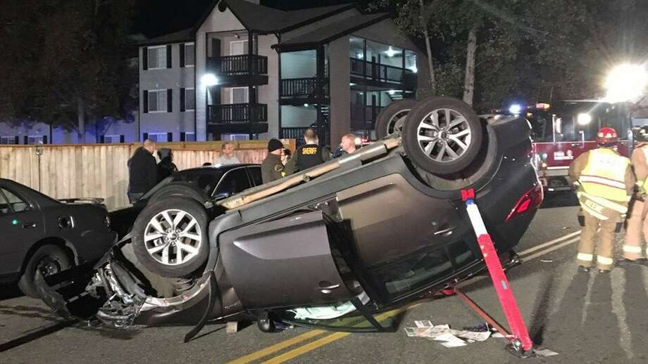 A man was trapped inside his car after a rollover crash overnight in Lynnwood. Photo: South Snohomish Fire And Rescue