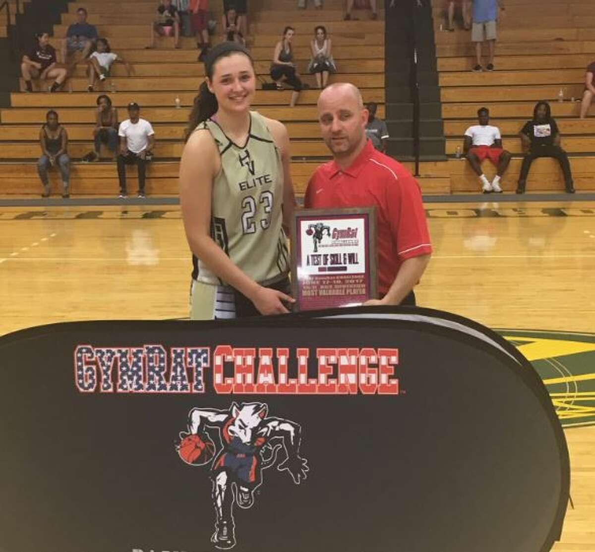 John Kmack, right with Alexa Kellner, a high school basketball star from Stamford, Conn. during the GymRat Challenge in June. Kellner, a senior, has committed to playing at the University of Massachusetts.