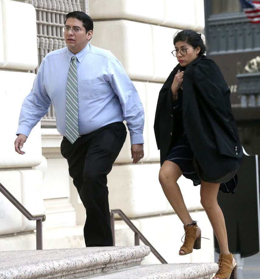 Witness Denise Cantu (right) enters the Hipolito F. Garcia Federal Building and U.S. Courthouse in San Antonio Wednesday. Cantu testified in a trial involving FourWinds Logistics, a now-defunct oil field services company accused of derfrauding her and other investors. Photo: John Davenport /San Antonio Express-News / ©John Davenport/San Antonio Express-News
