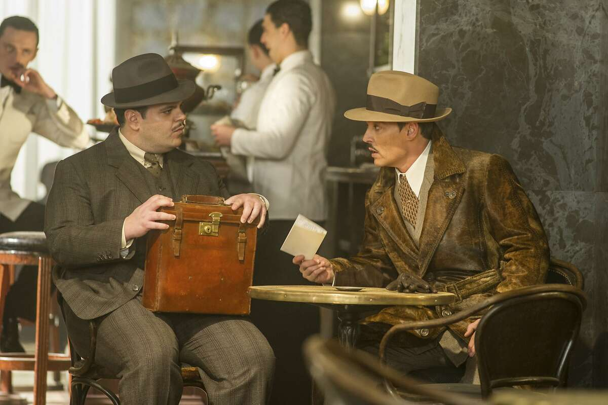 This image released by Twentieth Century Fox shows Josh Gad, left, and Johnny Depp in a scene from,