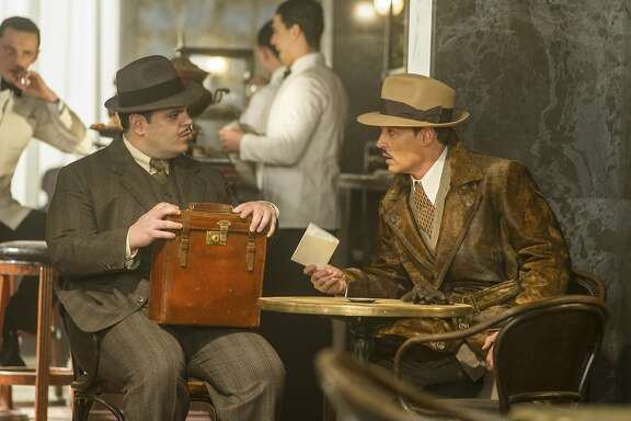 "This image released by Twentieth Century Fox shows Josh Gad, left, and Johnny Depp in a scene from, ""Murder on the Orient Express."" (Nicola Dove/Twentieth Century Fox via AP)"