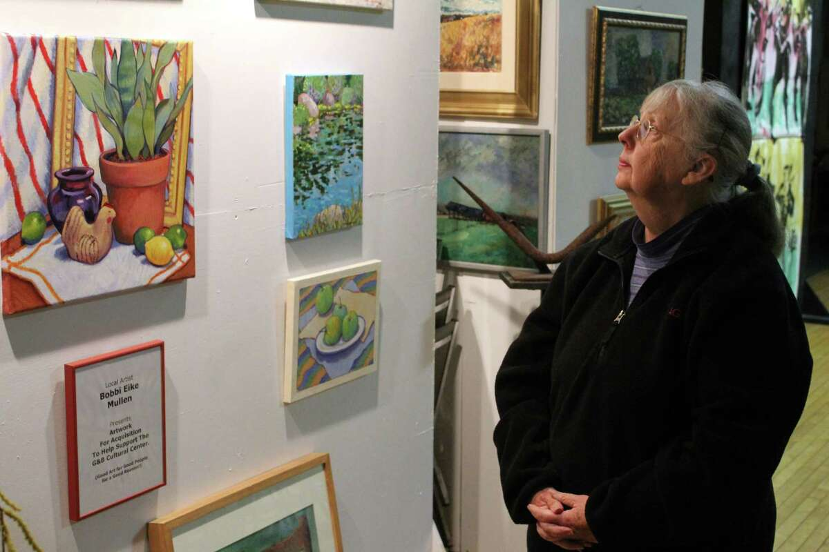 Bobbi Eike Mullen, 74, looks at her painting on view at the G&B Cultural Center at 49 New Street in Wilton.
