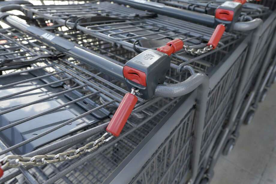 Shopping carts sit outside an Aldi store. Aldi is in the midst of remodeling 22 stores across Connecticut. Photo: File Photo / © 2017 Houston Chronicle