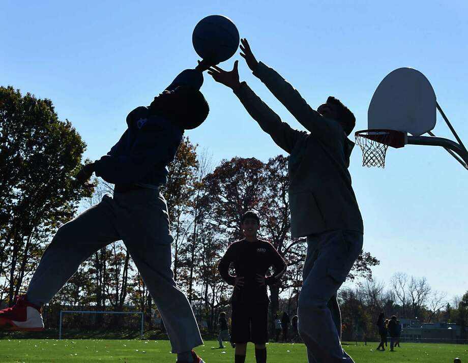 Kids play basketball during recess at Blue Creek Elementary School on Wednesday, Nov. 8, 2017 in Latham, N.Y. (Lori Van Buren / Times Union) Photo: Lori Van Buren, Albany Times Union / 20042088A