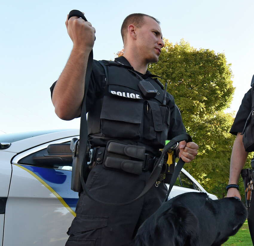 Cory Wagner and his partner K-9 Mick near Main Street Tuesday morning, Oct. 6, 2015, in Hoosick Falls, N.Y. (Skip Dickstein/Times Union)
