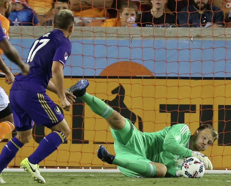 Goalkeeper Joe Willis, right, came up with two key saves in relief of suspended starter Tyler Deric in the Dynamo's postseason upset of the Portland Timbers. Photo: Yi-Chin Lee, Staff / © 2017  Houston Chronicle