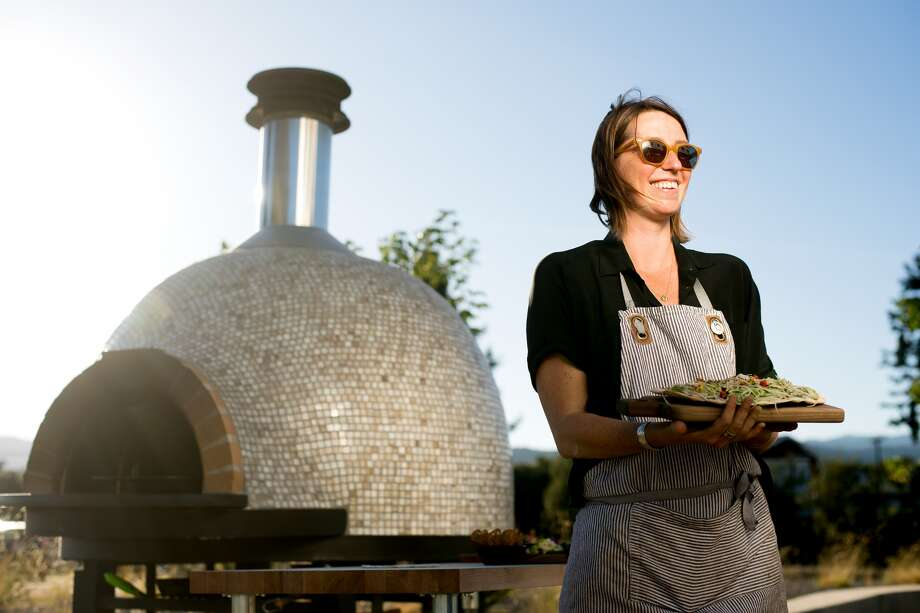 Winery chef Emma Sears prepares vegetable-focused dishes in a wood-fired oven.