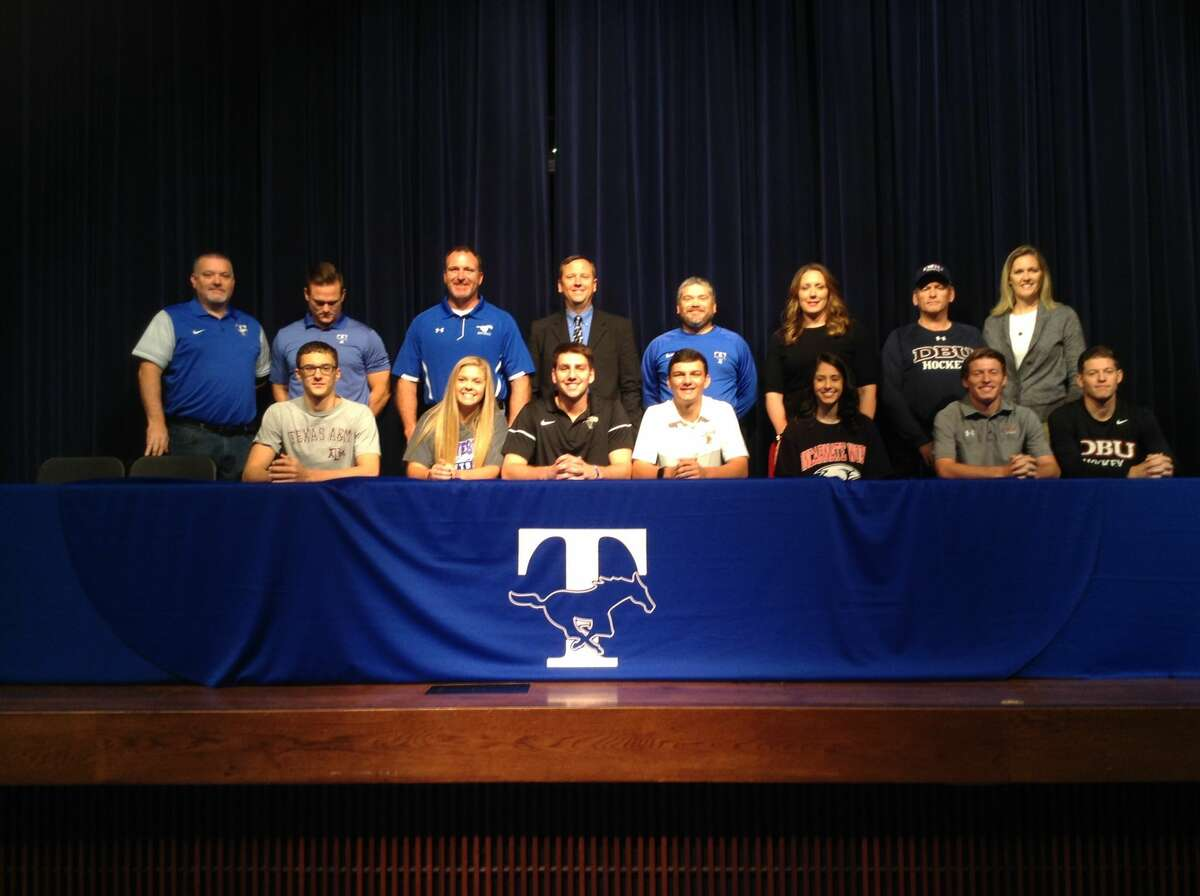 Taylor HS athletes during the early signing period: Bottom row, from left: Jacob Schababerle (Texas A&M-swimming), Kristen Meyer (Galveston College-softball), Enzo Sechi (University of Colorado-Colorado Springs-basketball), Chase Carlson (Lehigh University-baseball), Macy Ray (University Of The Incarnate Word-basketball), Randall Miller (Dallas Baptist University-ice hockey) and Hunter Miller (Dallas Baptist University-ice  hockey) Top row, from left: THS principal Christopher Morgan, coach Matthew Apple, coach Thomas Powell, coach Matthew Brayton, coach Matthew Glover, coach Blair Ary, coach Bill Miller, assistant athletic coordinator Brooke Plemons.
