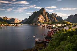 Reine, a small fishing village, as seen during sunrise in August on Lofoten Islands.