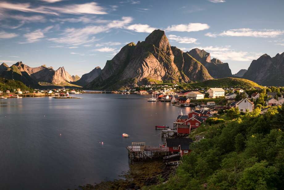 """""""The Lofoten Islands in Norway are an incredible place for people who love nature.I went there 8 years ago while visiting one of my friend studying in Scandinavia. We organized a road trip to the Lofotens. The area is unknown and we were almost the only tourists there.""""— Mimi Copi Photo: Dennis Fischer Photography/Getty Images"""