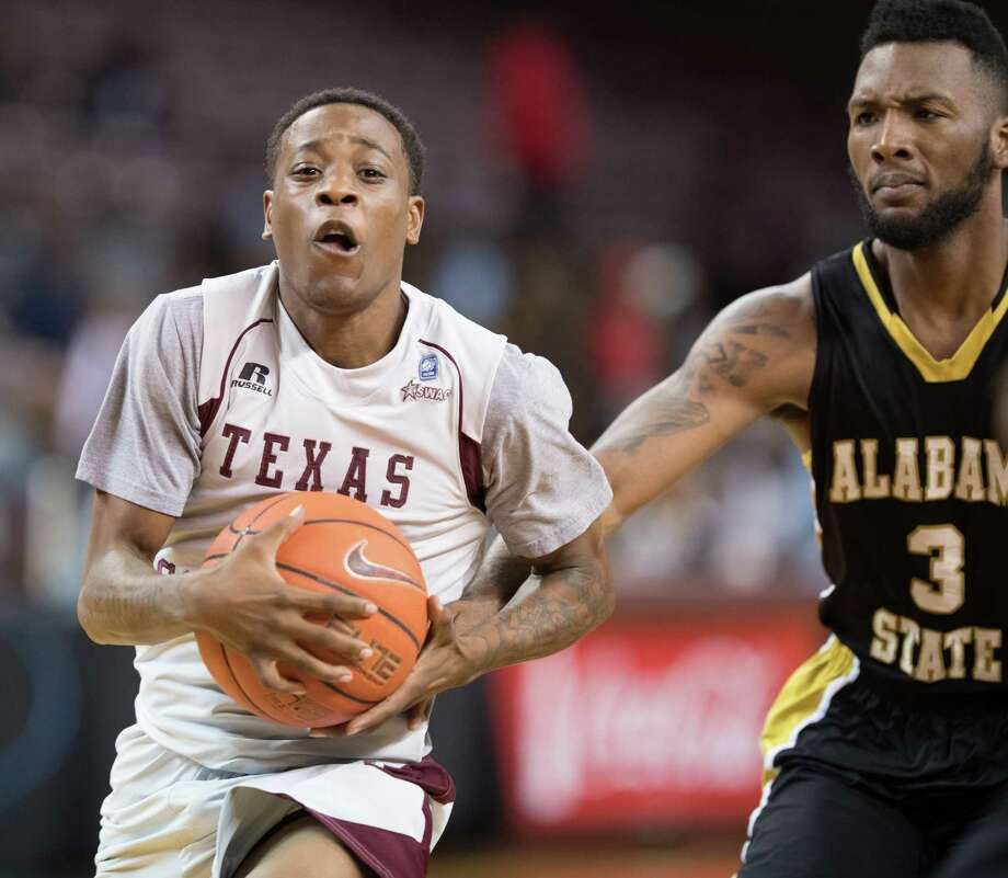 Demontrae Jefferson (3) of the TSU Tigers drives to the basket with Torlof Thomas (3) of the Alabama State Hornets  defending in a college basketball game on Tuesday, March 7, 2017 at H&PE Arena on the TSU Campus. Photo: Wilf Thorne / © 2017 Houston Chronicle