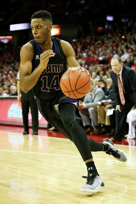 Zachary Hamilton #14 of the Prairie View A& Panthers dribbles the ball in the first half against the Wisconsin Badgers at the Kohl Center on November 27, 2016 in Madison, Wisconsin. Photo: Dylan Buell, Contributor / 2016 Dylan Buell