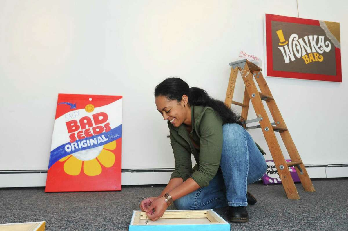 "Artist Tara Blackwell poses beside one of her works for the exhibit ""Corner Store"" inside the Stamford Art Association on Franklin Street in downtown Stamford, Conn. on Sunday, Nov. 5, 2017. The exhibit opens on Nov. 12."
