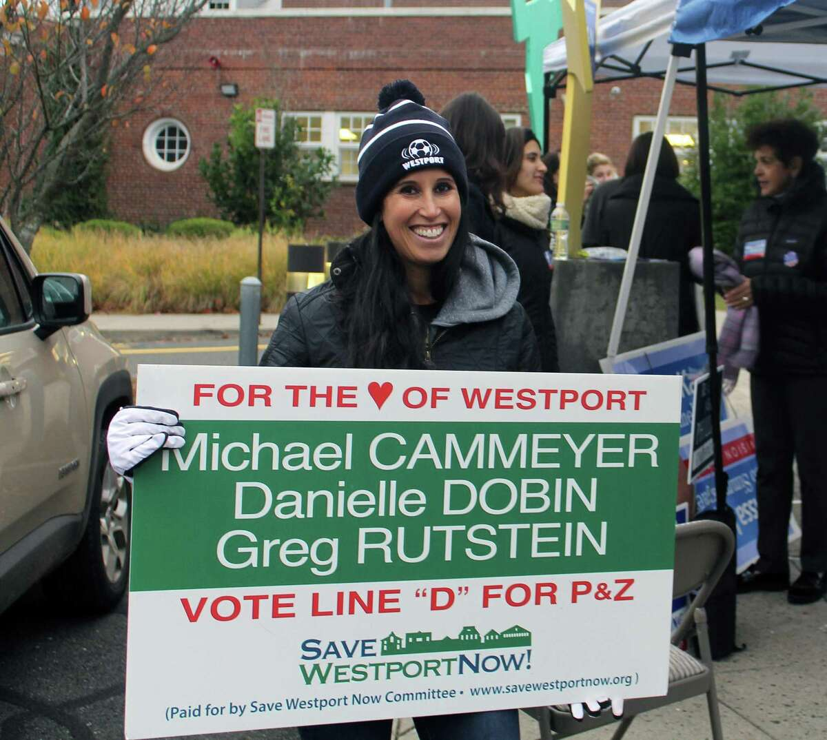 Megan Rutstein campaigns for her husband Greg Rutstein outside of Saugatuck Elementary School on Election Day. He won a seat on the Planning and Zoning Commission.