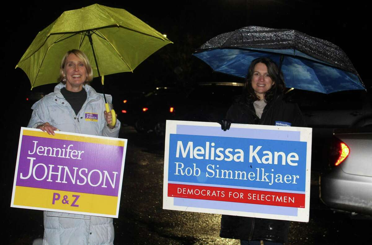 The Coalition for Westport Planning and Zoning Commission candidate, Jennifer Johnson, campaigns with a Kane supporter outsdide of Town Hall late on election night. Johnson did not win election to the commission.