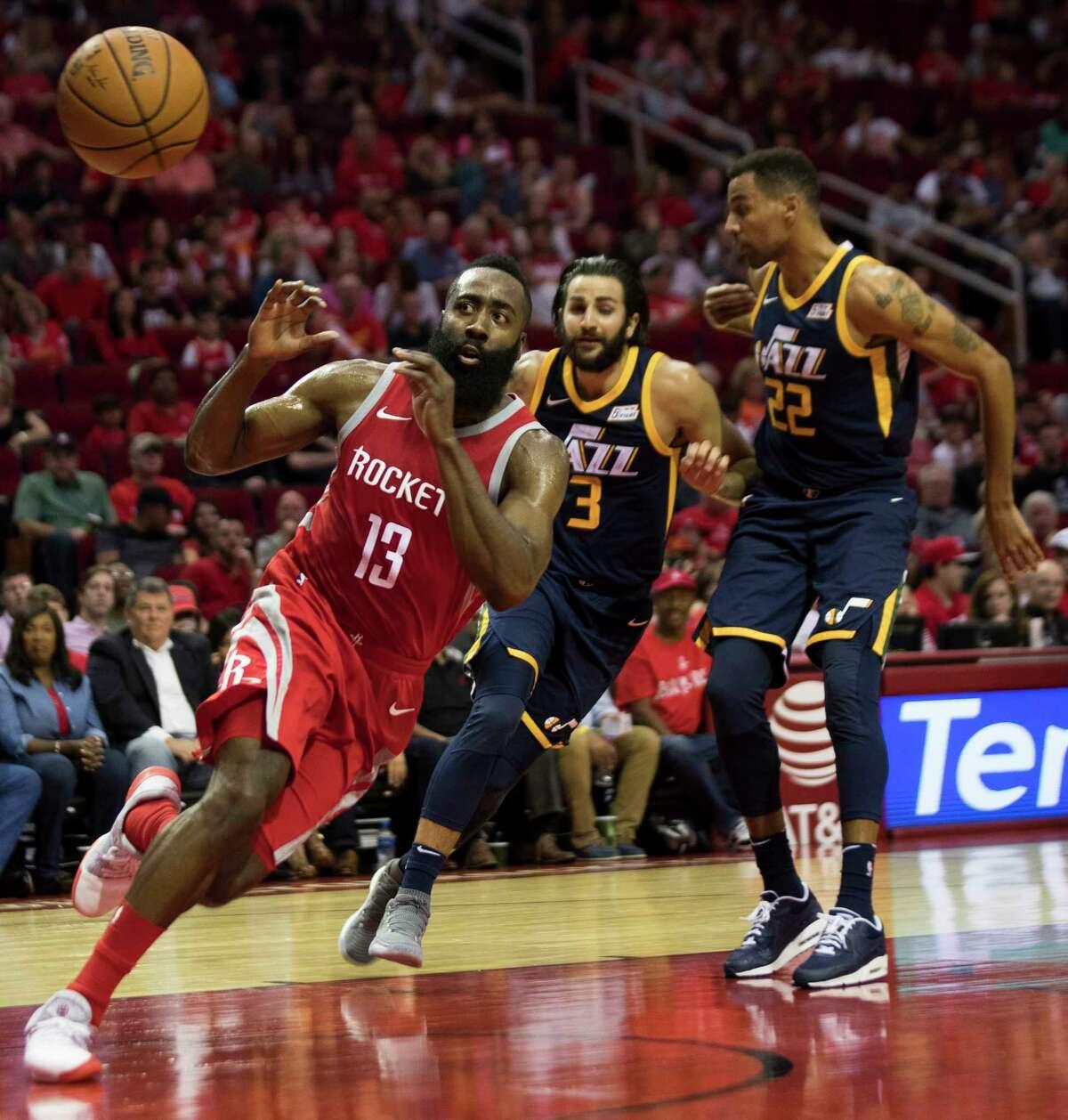 Houston Rockets guard James Harden (13) prepares to catch a pass under the pressure of Utah Jazz guard Ricky Rubio (3) and Utah Jazz forward Thabo Sefolosha (22) on Sunday, Nov. 5, 2017, at the Toyota Center in Houston. ( Marie D. De Jesus / Houston Chronicle )