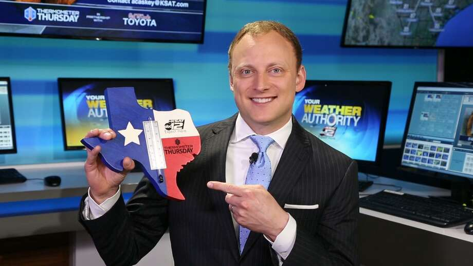 """KSAT-TV's weekday evening meteorologist Adam Caskey flashes one of his useful and kitschy handmade thermometers, which have become his trademark and landed him atop a national weathercaster """"cool"""" list compiled by the Washington Post. Photo: KSAT"""