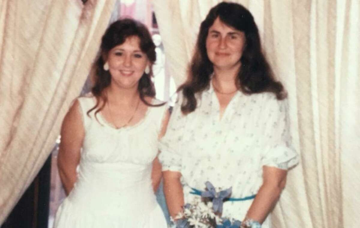 Peggy Lynn Warden, right, pictured at her sister's wedding in this undated photo. Warden was killed in an attack on a Sutherland Springs church by a mass shooter. Family members say she died protecting her grandson, Zachary Poston.