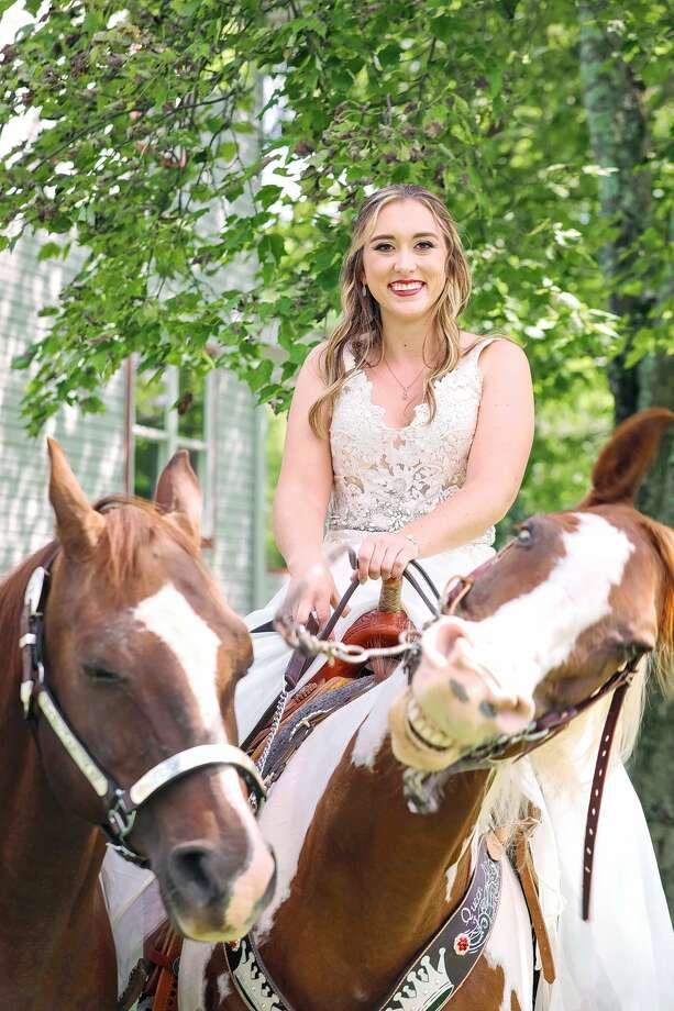 "A photo taken by photographer Tony Bendele showing bride Patti Womer went viral after capturing her horse ""smiling."" Photo: Courtesy Of Tony Bendele"