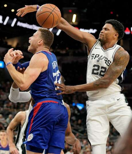 Spurs forward Rudy Gay swats the ball away from Los Angeles Clippers' Blake Griffin during San Antonio's victory Tuesday night at the AT&T Center. Photo: Darren Abate /AP Photo