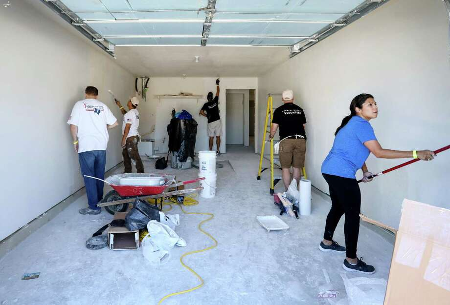 A Houston house is repaired in October after Hurricane Harvey flood damage. Strong Texas job gains are expected for the month by the Federal Reserve Bank of Dallas. Photo: Jon Shapley /Houston Chronicle / © 2017 Houston Chronicle