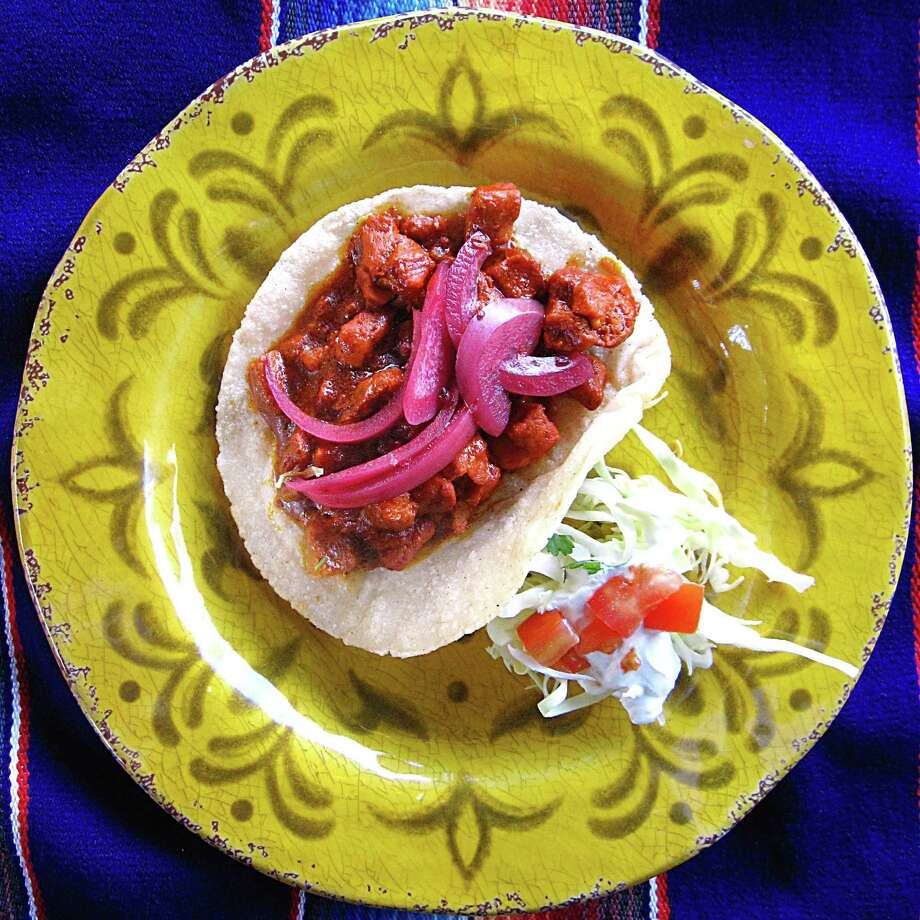 Cochinita pibil taco with pickled onions on a handmade corn tortilla from Cascabel Mexican Patio. Photo: Mike Sutter /San Antonio Express-News