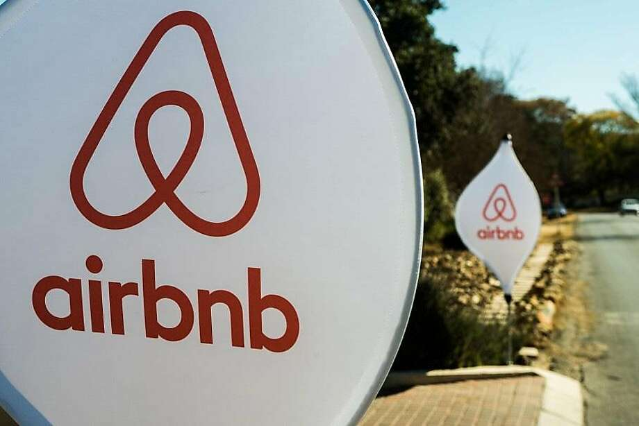 The logos of Airbnb Inc. sit on banners displayed outside a media event in Johannesburg, South Africa in July 2015. Photo: Waldo Swiegers, Bloomberg