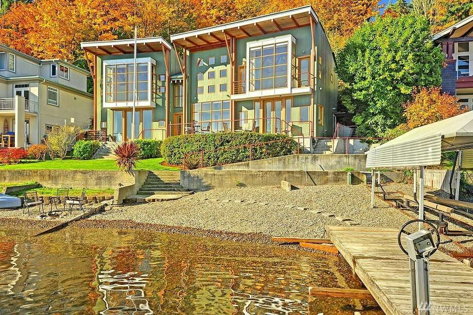 This home at 1618 W. Lake Sammamish Pkwy N.E. is listed for $2.848 million.It has three bedrooms, 3¼ bathrooms and spans 3,600 square feet.It has 85 feet of waterfront and a large dock with two boat lifts. Photo: Photos By Erica Anderson And Aimee Chase, Vista Estate Imaging/listing Courtesy Margo Allan, Windermere Real Estate/East