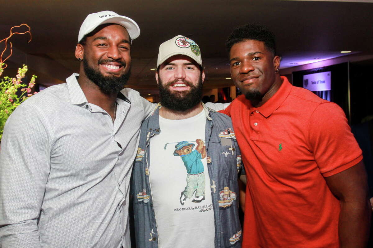 Houston Texans Zach Cunningham, from left, Ben Heeney and Kennan Gilchrist at the Taste of the Texans.