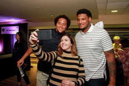 Whitney Lambert taking a selfie with Houston Texans Kendall Lamm, left, and Julien Davenport at the Taste of the Texans.