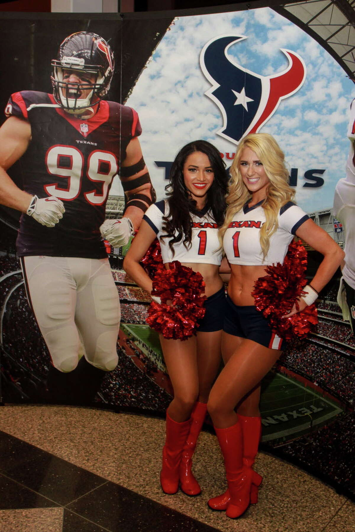 Texan cheerleaders Angelina, left, and Brittrini, at the Taste of the Texans.
