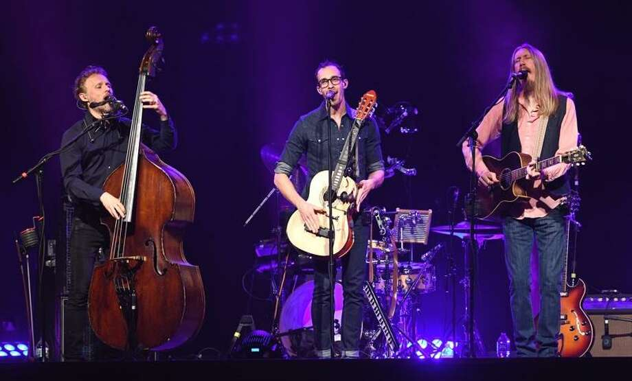 """The Wood Brothers, Chris Wood (Upright Bass), Jano Rix (multi-instrumentalist), and Oliver Wood (Guitarist) are shown entertaining a full house of fans at Infinity Music Hall in Hartford Oct. 2. The trio's first studio album, Ways Not to Lose, was produced by John Medeski. That debut album was the Amazon.com editors' number one pick in folk for that year, and the album also made NPR's Overlooked 11 of 2006. Their next album, The Muse was recorded at Southern Ground Studios in Nashville. The Wood Brothers are officially a Nashville based band, with Oliver having relocated in 2012, and Chris recently following. It was the first time the brothers have lived in the same city since early adulthood. Their follow up album, """"Paradise"""", was the first album in which all three members of the Wood Brothers share songwriting credits, due to the fact they were all living in Nashville and could work together on songs. To learn more about The Wood Btothers, go to www.thewoodbros.com Photo: Photo By John Atashian / John Atashian"""