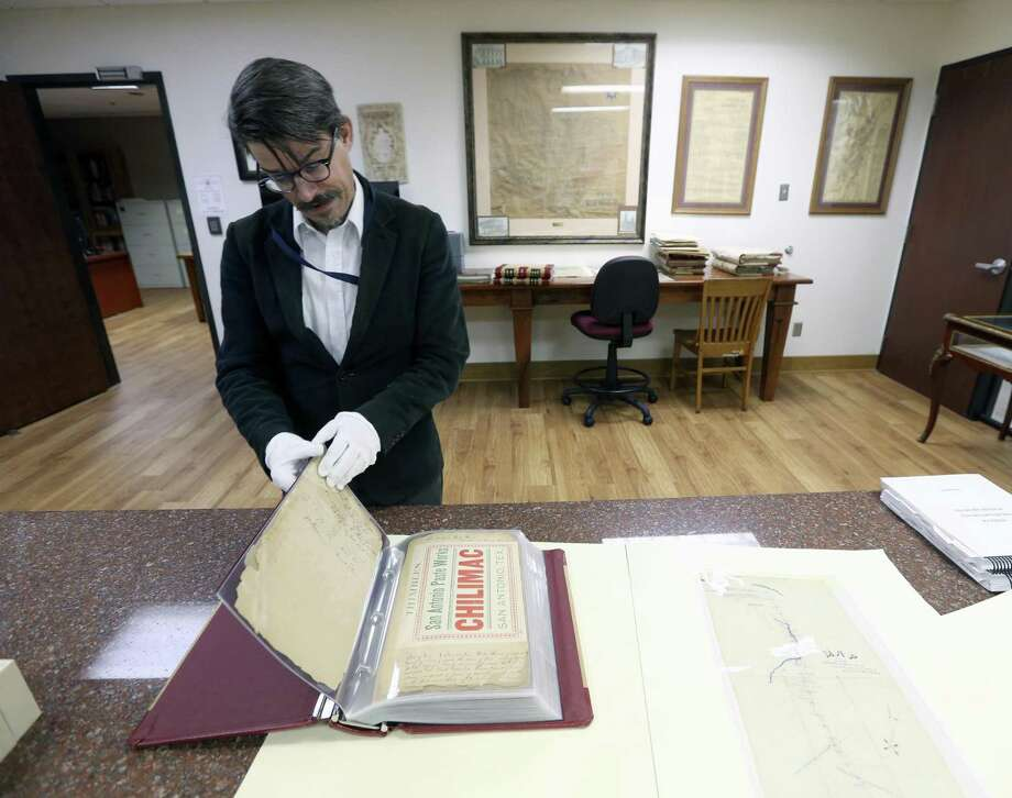 David Carlson looks through a collection Nov. 1 of early Bexar County patent records in the Bexar County Spanish Archives collection. Photo: William Luther /San Antonio Express-News / © 2017 San Antonio Express-News
