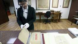 David Carlson looks through a collection Nov. 1 of early Bexar County patent records in the Bexar County Spanish Archives collection.