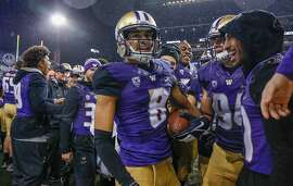 SEATTLE, WA - NOVEMBER 04:  Punt returner Dante Pettis #8 of the Washington Huskies is congratulated by teammates after returning a punt for a touchdown against the Oregon Ducks at Husky Stadium on November 4, 2017 in Seattle, Washington. The return for a touchdown was the ninth in Pettis' college career, setting an NCAA Division I record.  (Photo by Otto Greule Jr/Getty Images)