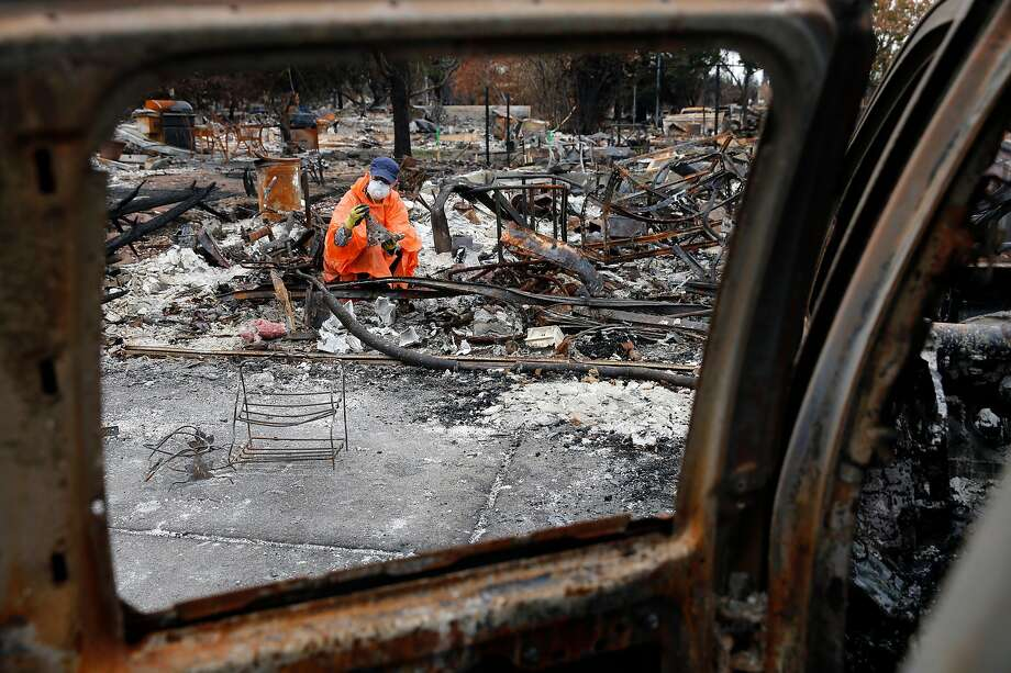 Teresa Philbin searches her property at the Coffey Park neighborhood in Santa Rosa for any sal vageable items. She has finally found an apartment to rent one month after her home burned. Photo: Michael Macor, The Chronicle